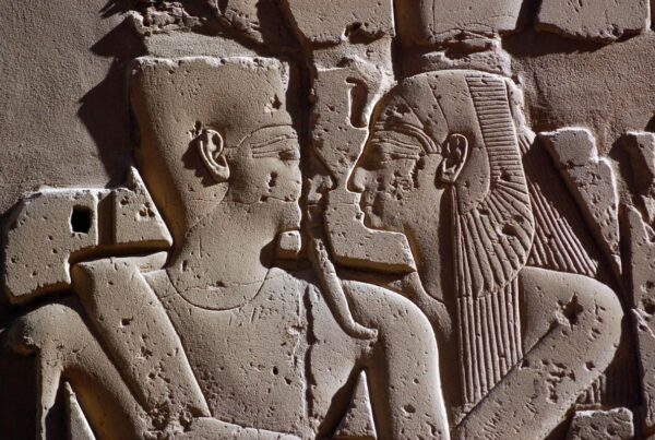 Ancient Egyptian Embrace Pharaoh Ramses and Queen Nefertiti embracing each other.